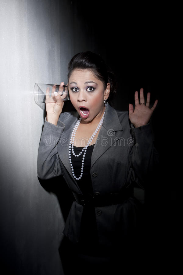 Download Pretty Young Hispanic Woman Using Glass To Eavesdr Stock Image - Image: 9542497