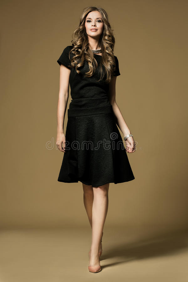 Pretty young lady. In a fashion pose stock photography