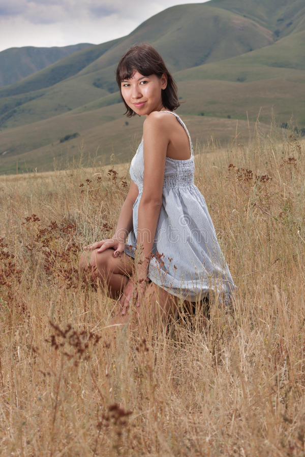 Download Pretty Young Lady On A Meadow Hills Stock Image - Image: 23894659