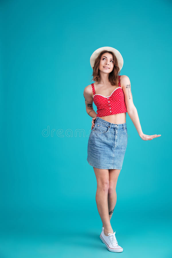 Pretty young lady standing and posing isolated stock images