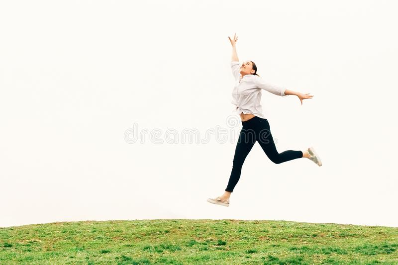 A young woman, jumping against sky backgroung, freedom concept stock images
