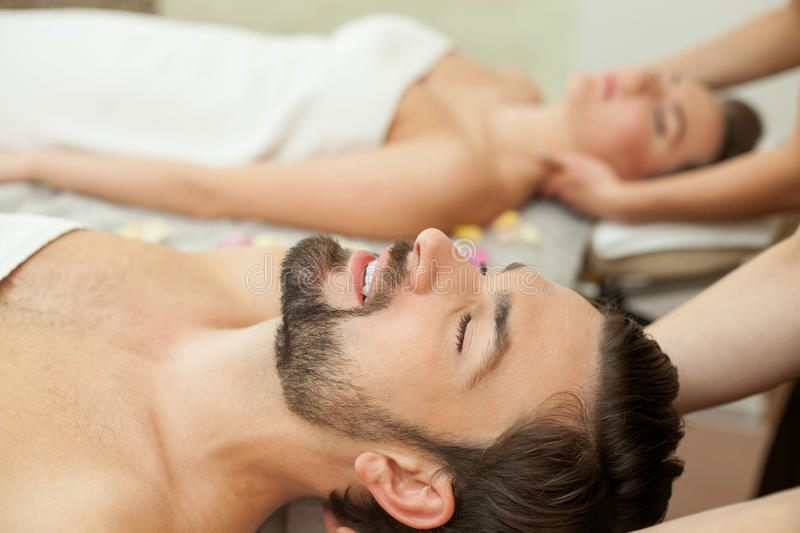 Pretty young married couple at beauty salon stock image