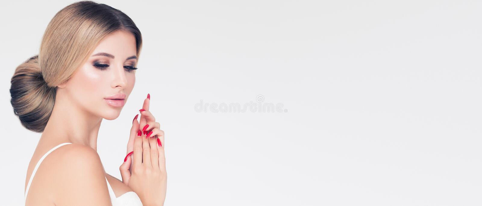 Pretty young model woman with perfect blonde hair, makeup and manicure on white banner background royalty free stock photos