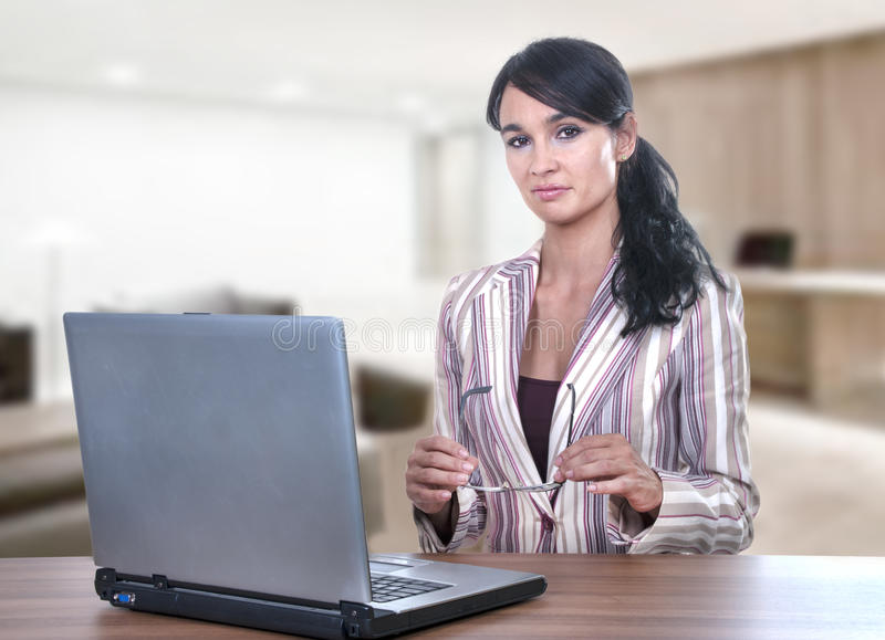 Pretty young office worker stock photos