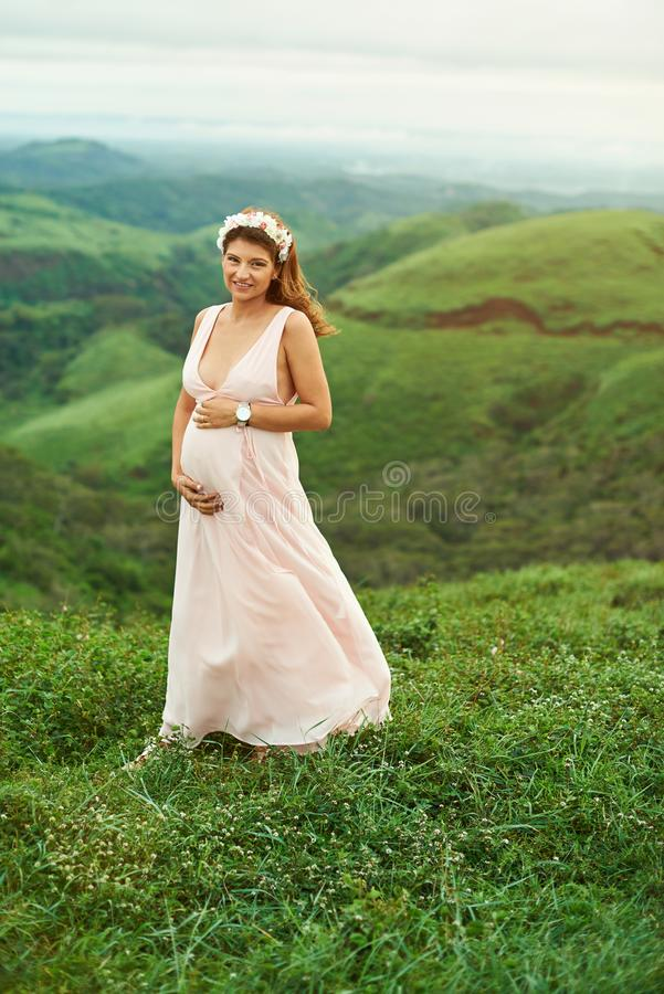 Pretty young pregnant woman royalty free stock photo