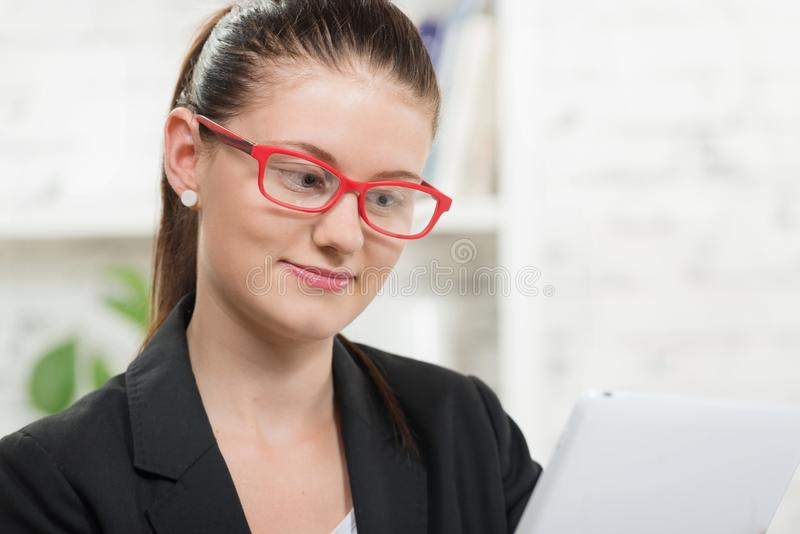 Pretty young secretary. With red glasses on head stock images