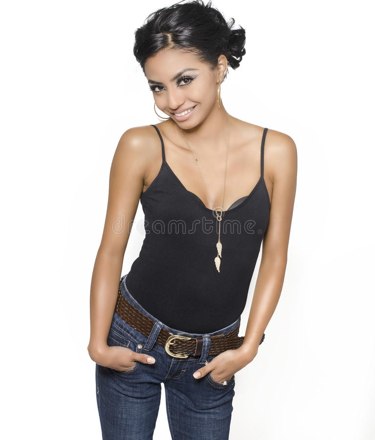 Pretty young smiling woman casually dress. Ed in denim and black top isolated against white stock image