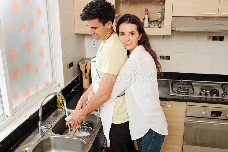 When husband washing dishes royalty free stock images