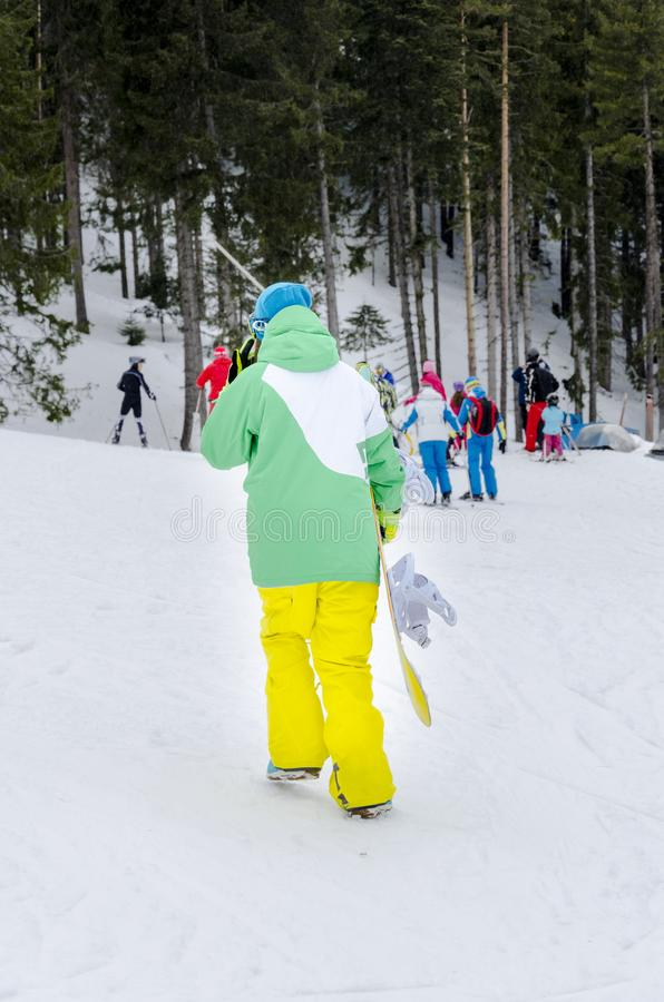 Pretty young snowboarder girl having winter rest outdoor, Bansko royalty free stock photo