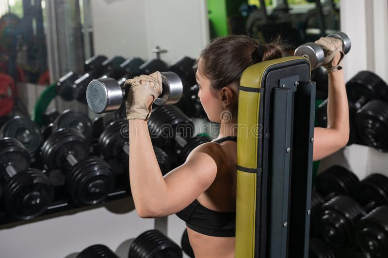 Pretty young sport woman is Workout in gym, Healthy lifestyle. Active, athlete, body, dumbbell, exercise, fit, fitness, girl, strong, training, weight royalty free stock photography