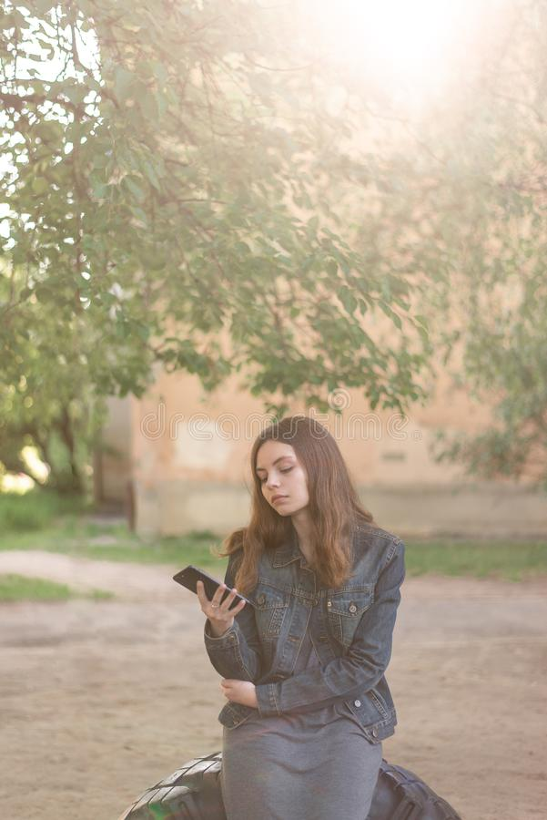 Pretty teen girl using phone in social media stock photos