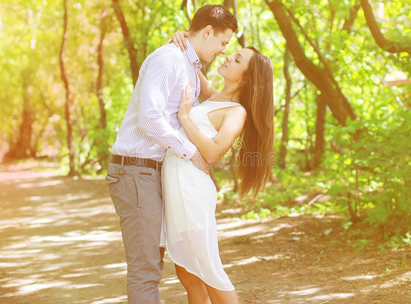 Pretty young teenagers couple in love kiss stock photography