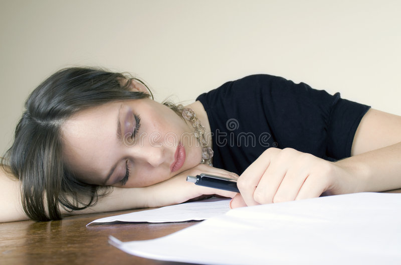 Pretty young woman asleep in the office