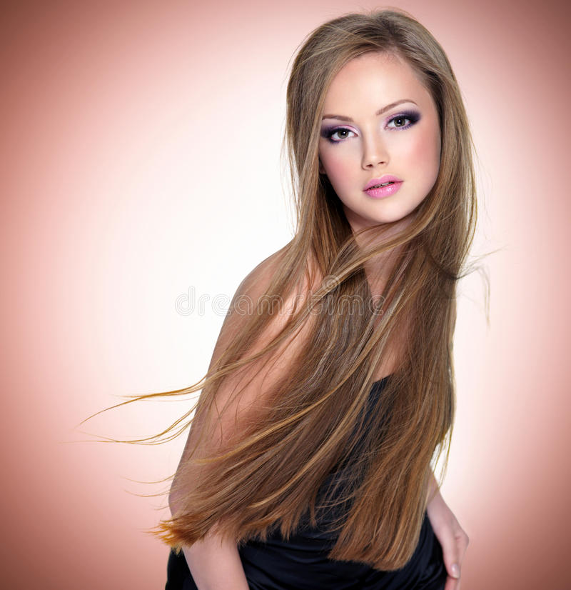 Pretty young woman with beautiful long straight stock photography