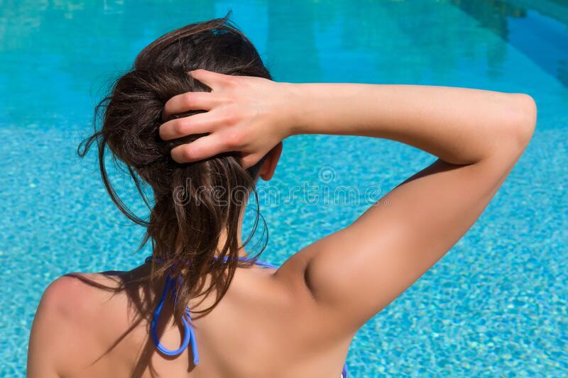 Looking  woman at swimming pool royalty free stock photography