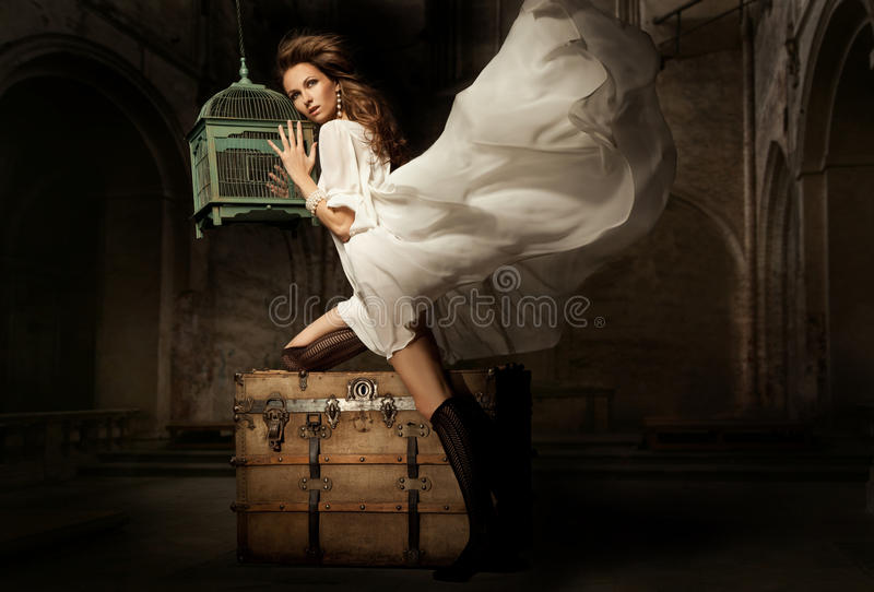 Pretty young woman with cage.  royalty free stock photos