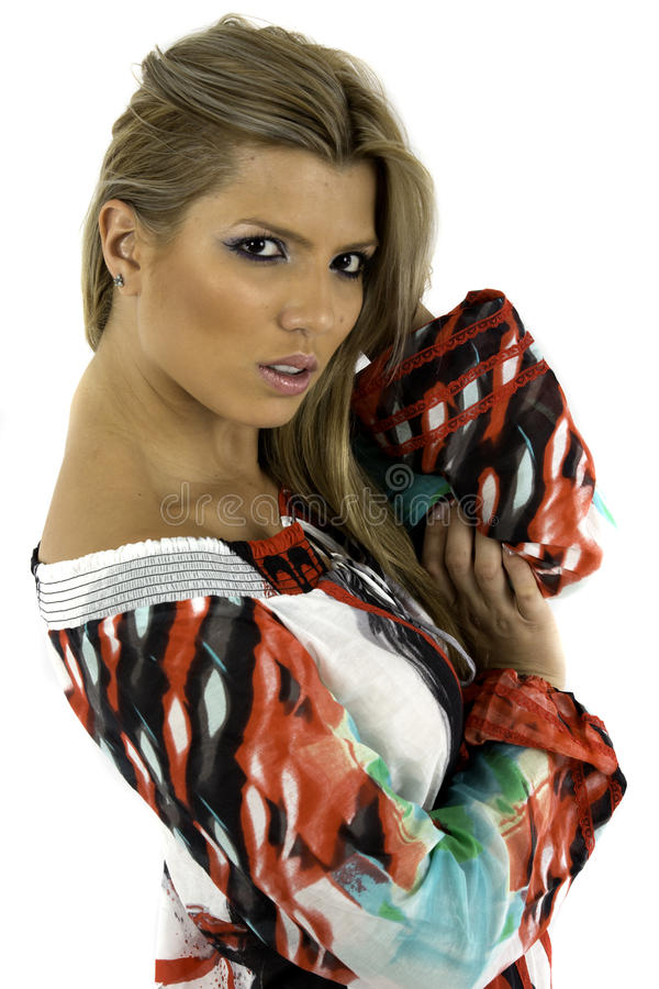 Pretty young woman is a colorful blouse royalty free stock image
