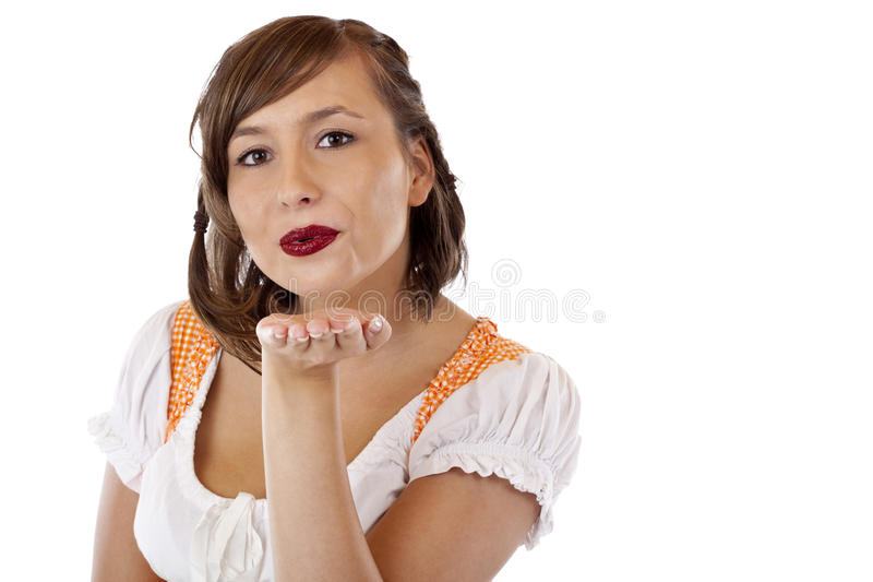 Download Pretty Young Woman In Dirndl Blows A Kiss Stock Photo - Image of background, female: 19332824