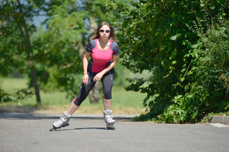 Pretty Young Woman Doing Rollerskate On A Track Stock