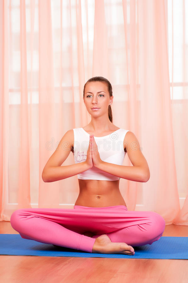 Download Pretty Young Woman Doing Yoga Exercise On Mat Stock Photo - Image: 22544050