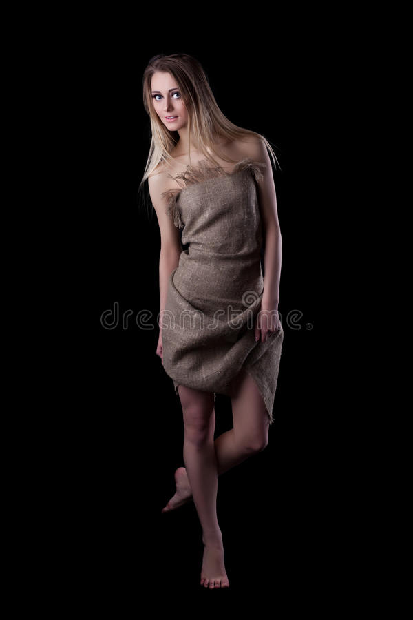 Pretty young woman in dress stock photography