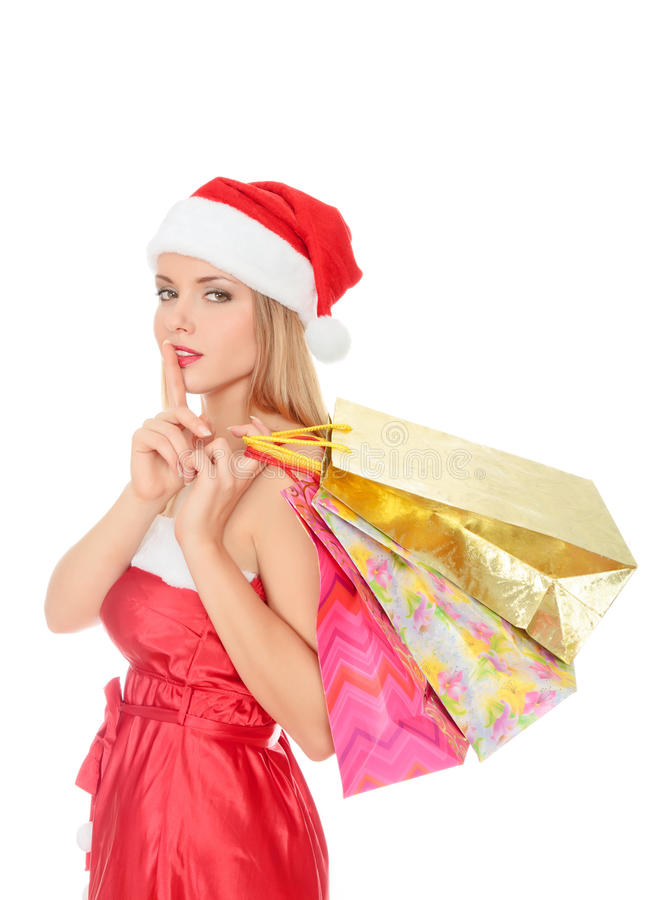 Pretty young woman dressed as Santa royalty free stock photo