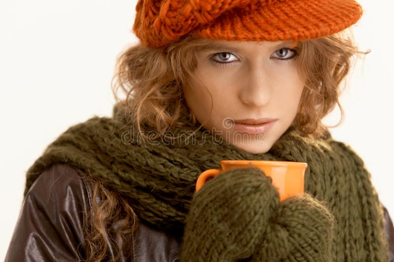 Pretty young woman dressed up warm drinking tea. Pretty young woman dressed up warm, drinking hot tea, freezing royalty free stock photography