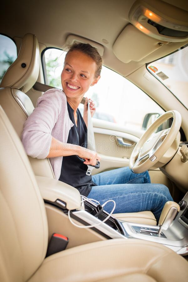 Pretty, young woman  driving a car stock image