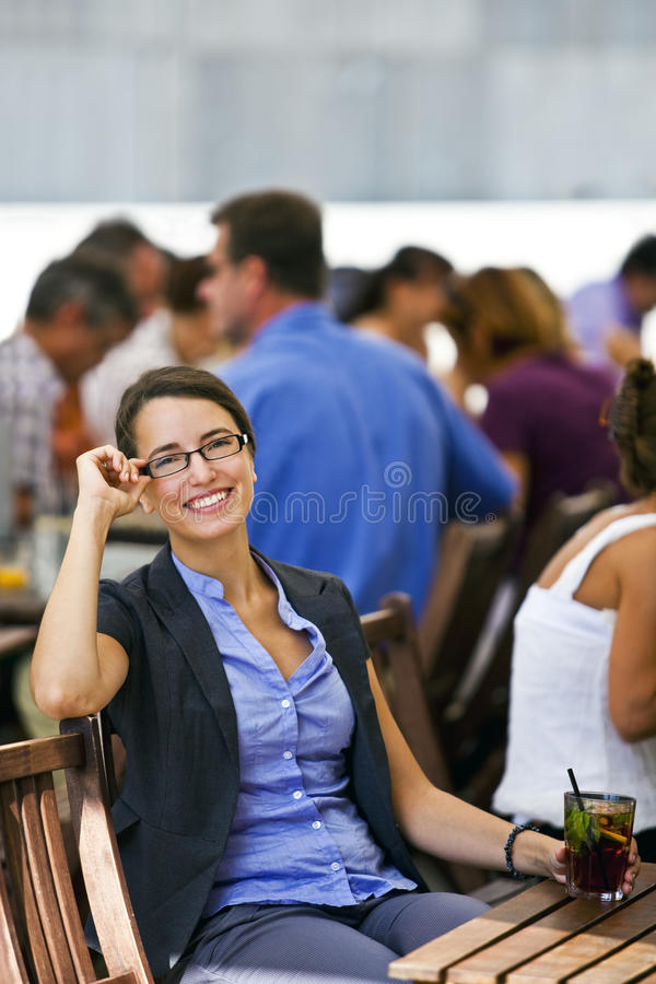 Pretty young woman enjoys her break from work stock photo