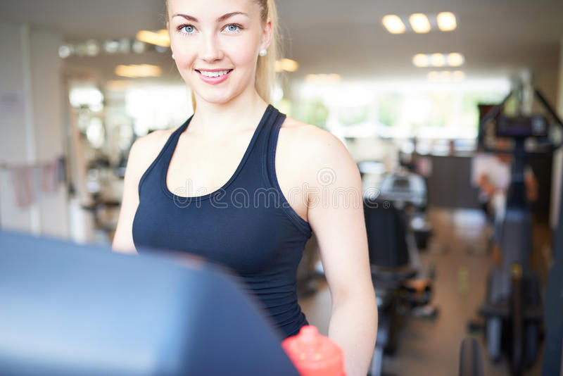 Pretty Young Woman Exercising Inside Fitness Gym stock images