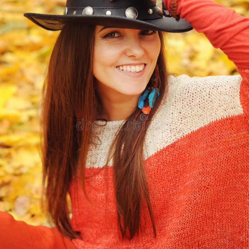 Pretty young woman fashion close up portrait, leather hat and ha stock image