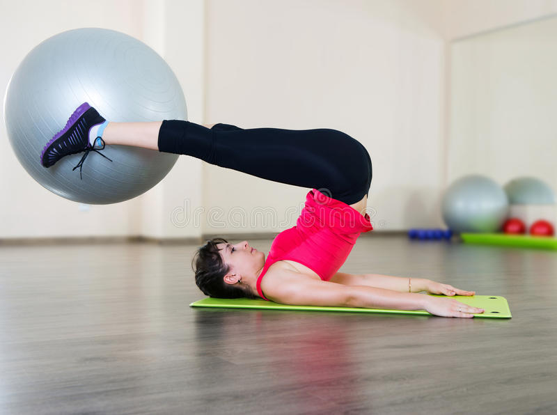 Young woman fitness workout in gym with fitball stock images