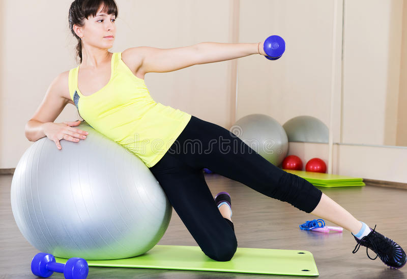 Young Woman Fitness Workout In Gym With Fitball Stock Photography