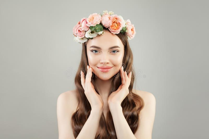Pretty young woman with flowers. Skincare and facial treatment concept royalty free stock photo