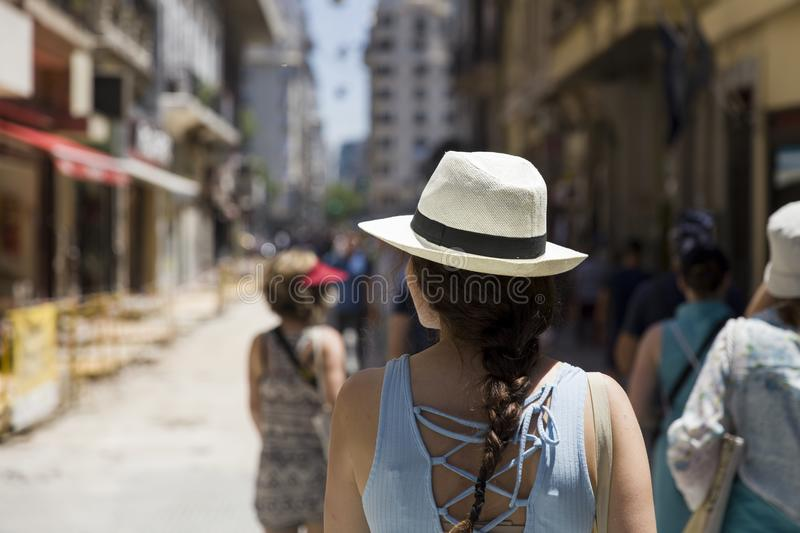 Pretty young woman with hat on the street of Buenos Aires stock photography