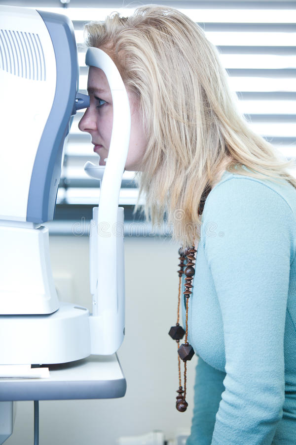 Pretty Young Woman Having Her Eyes Examined Royalty Free Stock Photos