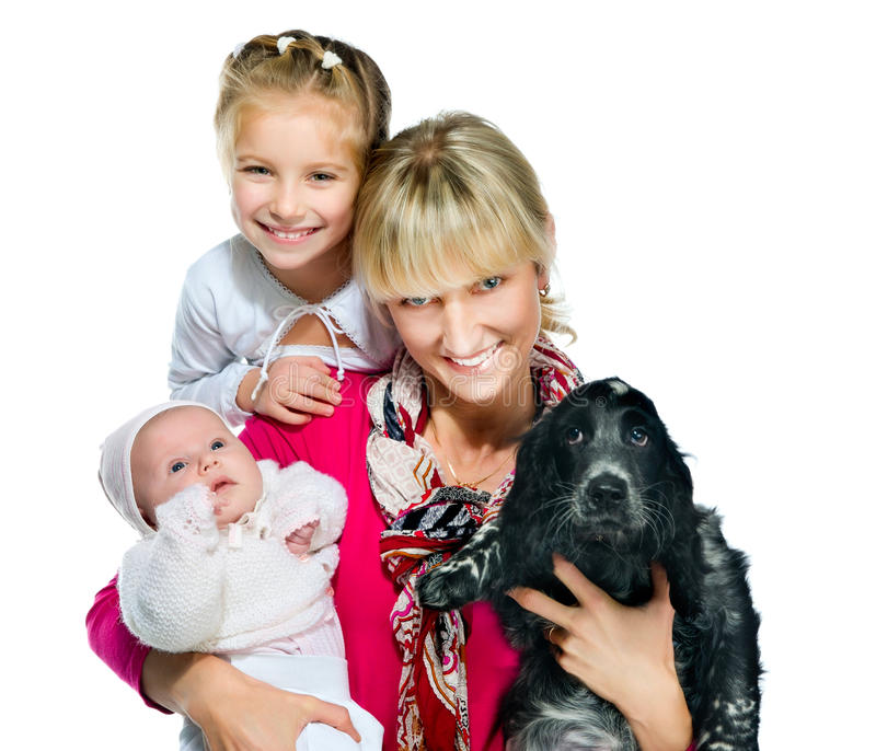Pretty young woman with her daughters and dog royalty free stock photo