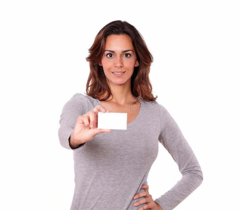 Pretty young woman holding blank business card royalty free stock photography
