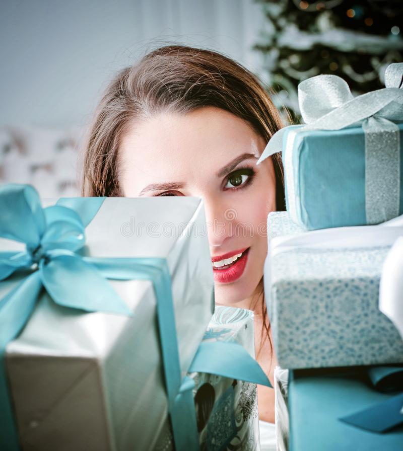 Pretty woman holding a bunch of gift boxes royalty free stock image