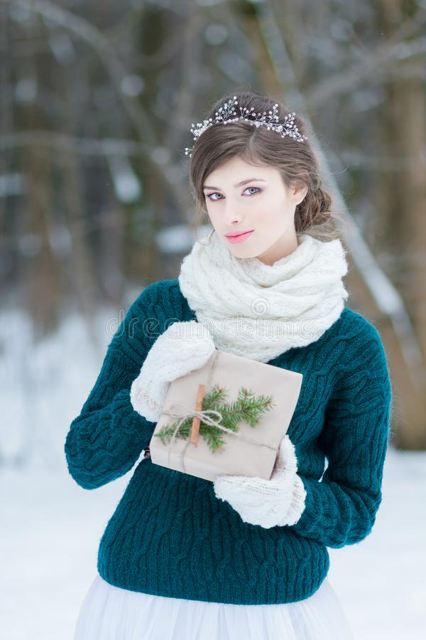Pretty young woman holding Christmas gift. In hands stock images