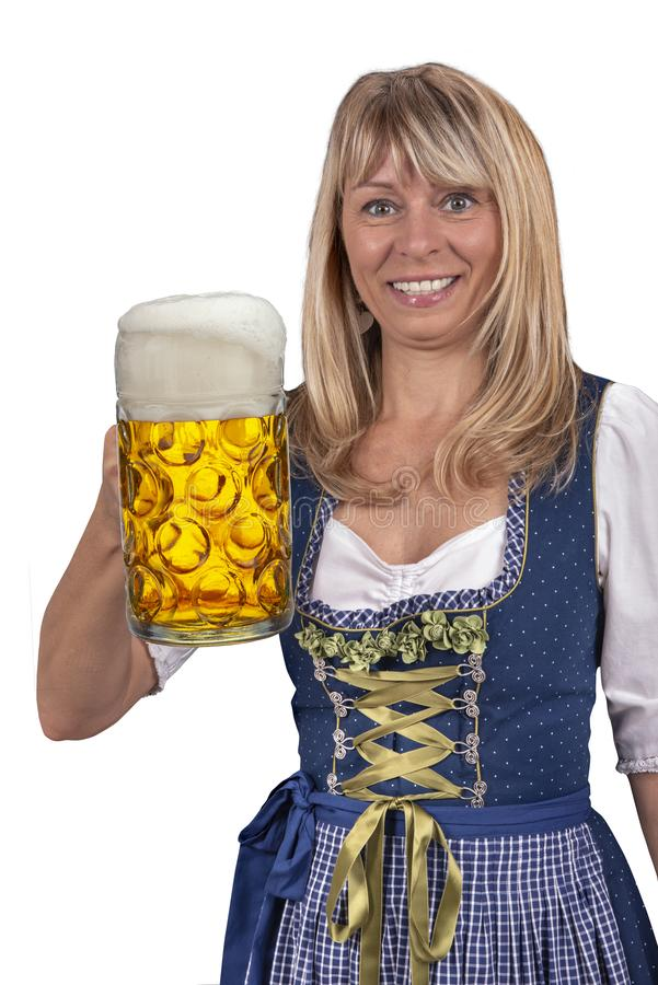 Pretty young woman holding a glass of beer at Oktoberfest in Munich royalty free stock photos