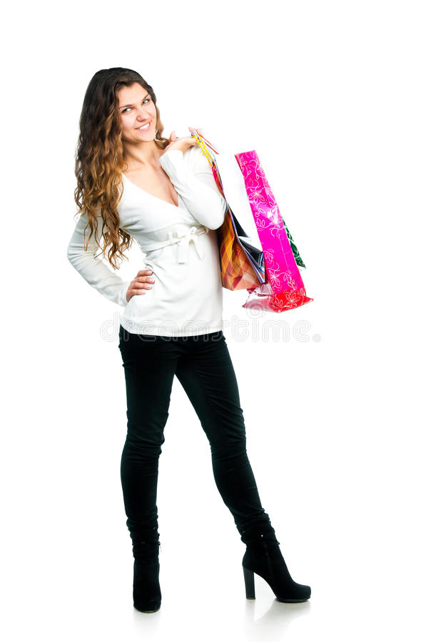 Download Pretty Young Woman Holding Shopping Bags Stock Image - Image: 27548391