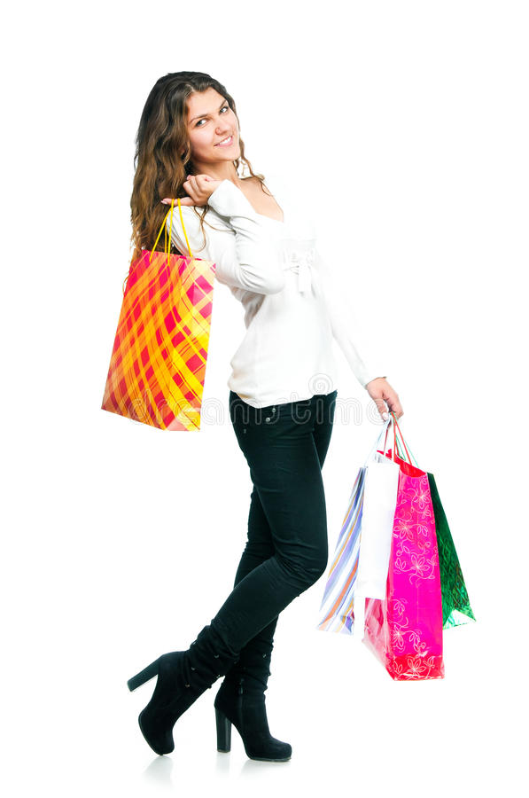 Download Pretty Young Woman Holding Shopping Bags Stock Photo - Image: 28046652