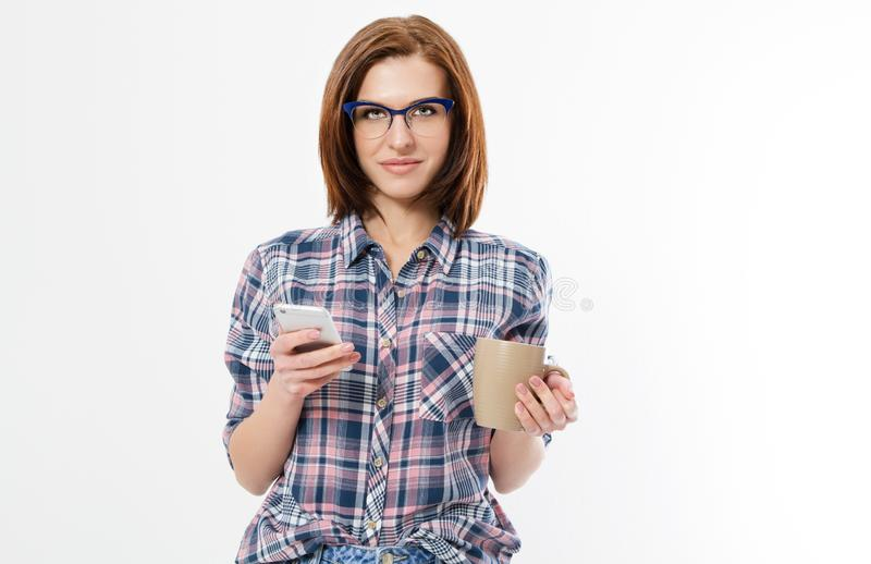 Pretty young woman holding smart phone, using device, wearing stylish glasses, smiling, isolated on white background, denim shirt stock images