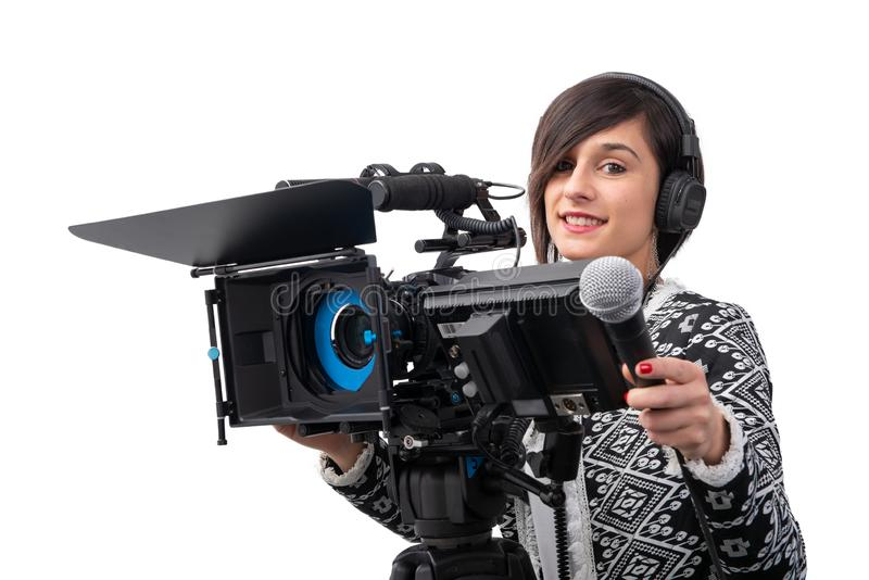 Pretty young woman  journalist with microphone and camera in television studio on white stock photo