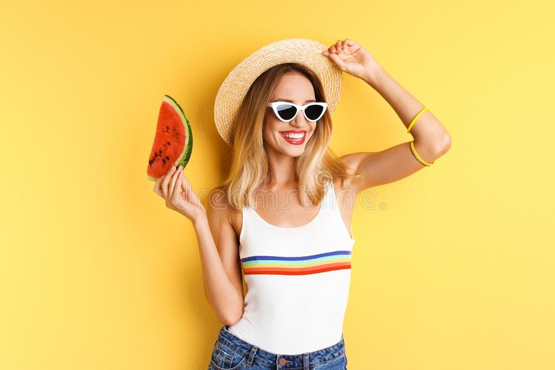 Pretty young woman with juicy watermelon stock photo