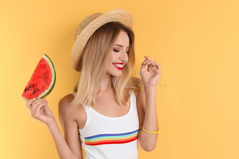 Pretty young woman with juicy watermelon stock photography
