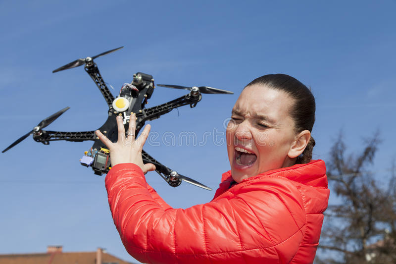 Pretty young woman just a moment before drone attack stock photography