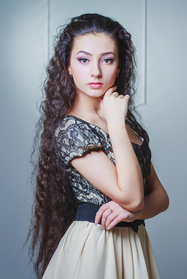 Pretty young woman with long hair royalty free stock images