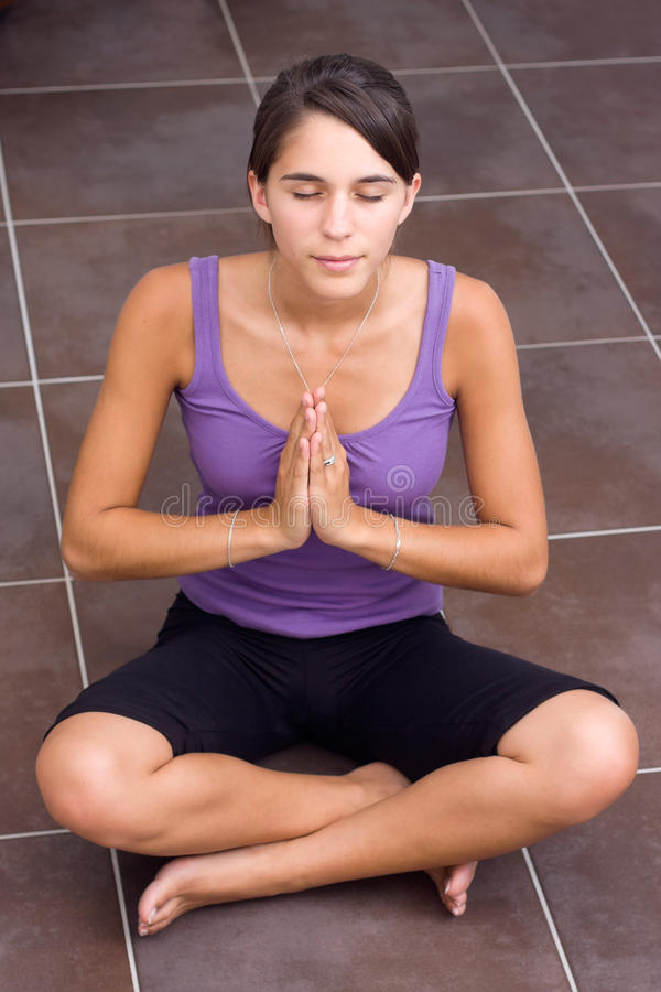 Download Pretty Young Woman Meditating Stock Photo - Image: 20702242